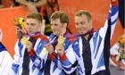 Philip Hindes, left, Jason Kenny, centre, and Chris Hoy take gold in the Olympic men's team sprint.