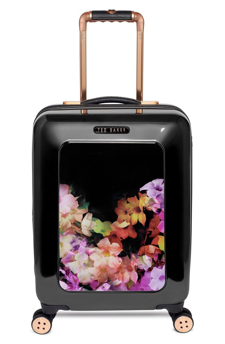 Stand out from a sea of suitcases with this floral hard shell one from Ted Baker. So adorable!