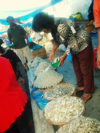 My Inong is buying ikan asin 'salted fish'