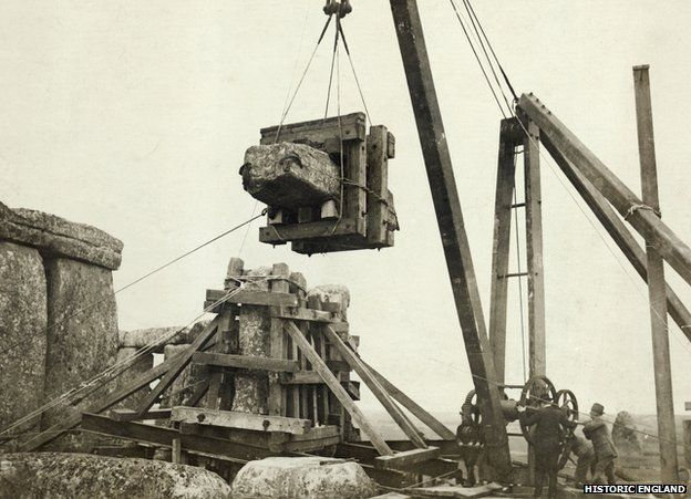 Lintel being lifted for replacement after adjustment of stones 6 and 7, Stonehenge, Wiltshire 17 March 1920. Office of Works