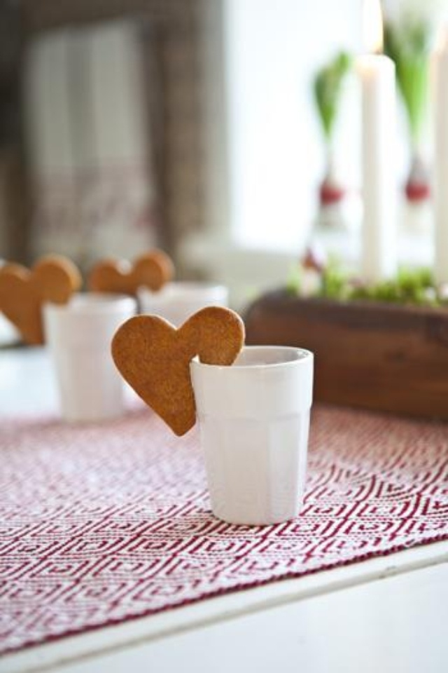heart pepparkakor cookies, notched for a mug....and LOVE that Scandinavian textile on the table!!