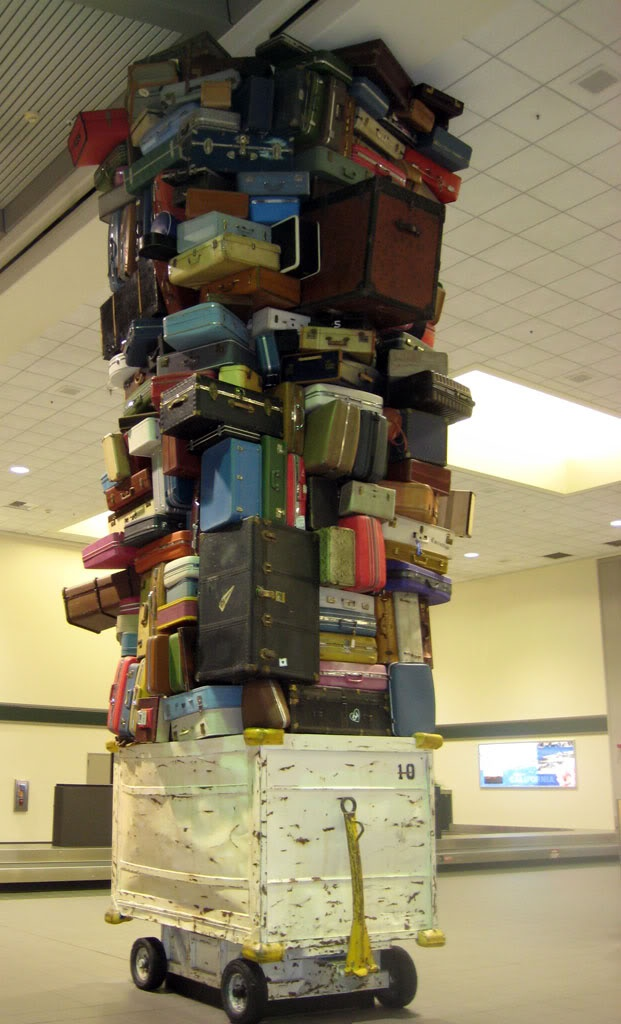 Cool Luggage Art display at Sacramento Airport! It's one of my favorite discoveries while traveling .