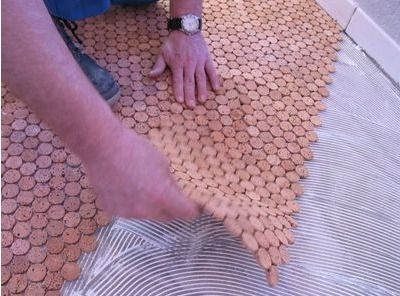 We carry Versacork, a penny tile style product for adding a lot of cork character to your bathroom or kitchen or anywhere where you want a patterned warmth! Think vertical applications too!