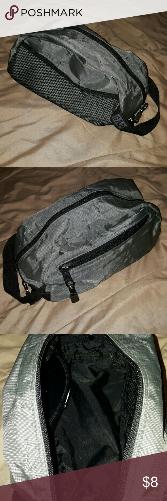 Gap Toiletry Bag Grey nylon toiletry bag. Two outside pockets  (one mesh one zip), two inside pockets (one mesh one zip). Great for traveling. Lots of use left in this bag! No damages! GAP Bags Cosmetic Bags & Cases
