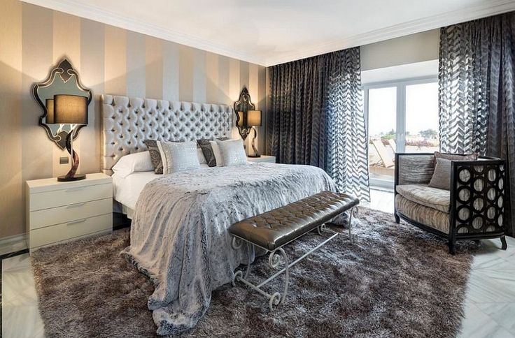 Vertical striped accent walls are perfect for rooms with low ceilings [Design: Ambience Home Design]