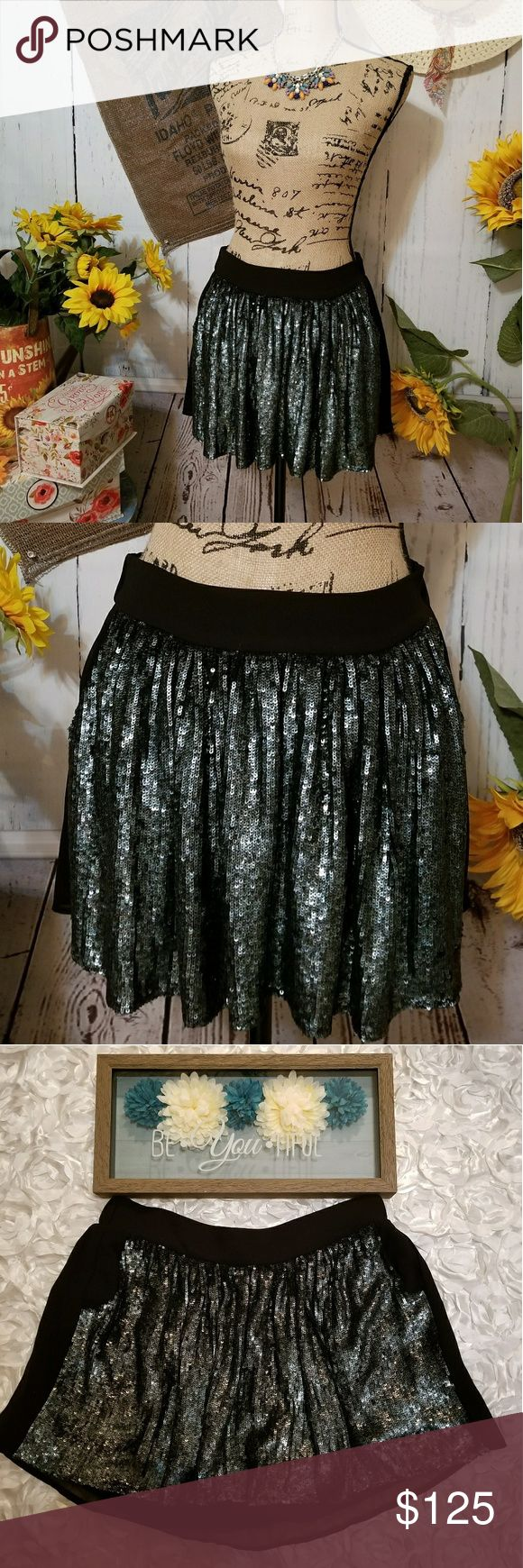 "*NEW ARRIVAL!! LITTLE DESIGNER SEQUINED MINI SKIRT MSRP $238!! GORGEOUS!! Wow NICE!! Bought exclusively for Poshing. ""Smile SUPER CUTE LITTLE black SEQUINED MINI SKIRT. Sequins are a shimmery bluish green. GORGEOUS! HAS 2 little hand pockets in front hard to see in pics. MEASURES about 14 in long.  Extremely beautiful and sporty with the little pockets! Fully lined and is not fitted, is swing style. Dry clean only. 100% poly. VERY unique and GORGEOUS!! Have SM&MED! Chaser Skirts Mini"
