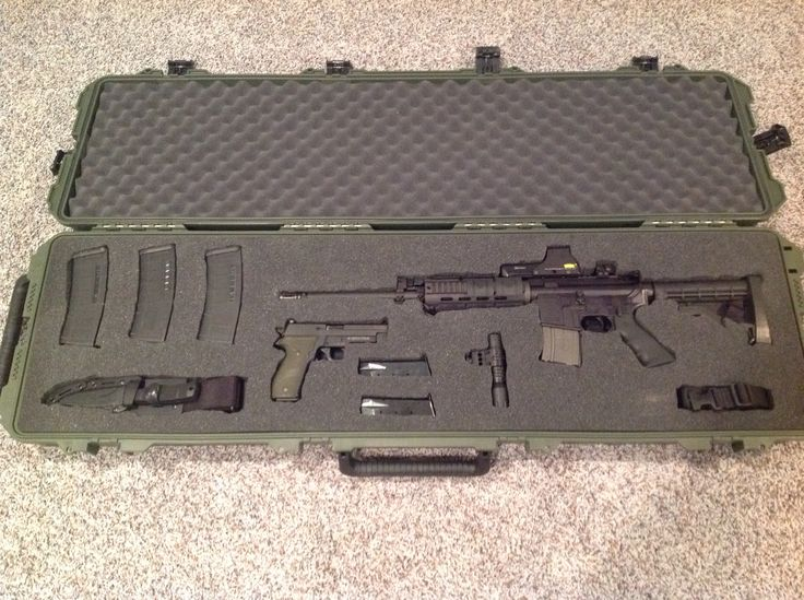 My custom Pelican Case. Bushmaster AR with Eotech sight, sig P226, Surefire light, Sealpup Fixed blade, 6 30 round And 1 20 round AR mags, 5 15 round Sig 9 mm mags and tacticle 2 point sling.