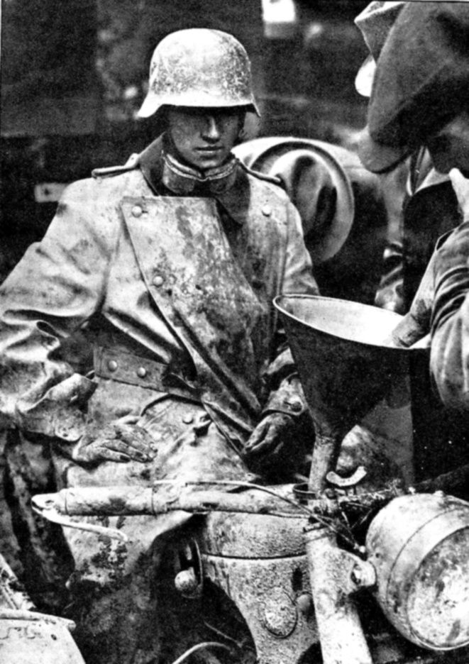 WWII. German motorcycle courier gets his machine fueled up. From the looks of both man and machine, the ride hasn't been easy, with mud being the primary problem. Lone couriers had one of the most dangerous jobs, often crossing hostile territory with only speed and a rifle or SMG for protection. Losses in their ranks was predictably heavy.