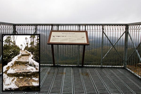Devils Gullet viewing platform with snow-covered steps in the north west coast region of Tasmania.  Article and photo by Carol Haberle for www.think-tasmania.com