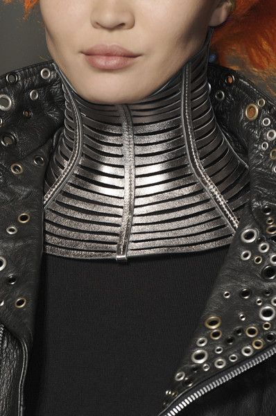 Strange metal necklaces that cover the entire neck are fashionable in Volantis, Jean Paul Gaultier Fall 2010