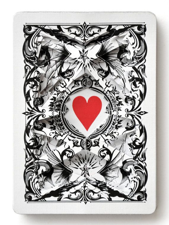 This is an actual deck of playing cards. I cut each card by hand and then glue them together. No two decks are alike. The four digit number on