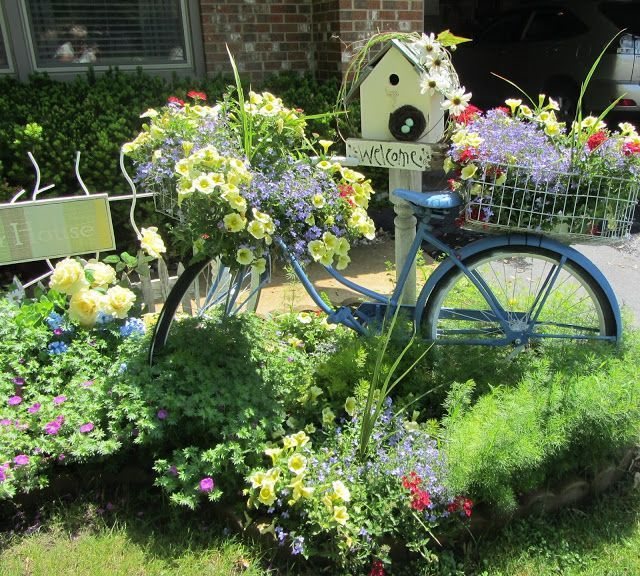Want to lean a bicycle against a tree in the yard.  Beautiful overflowing with flowers!