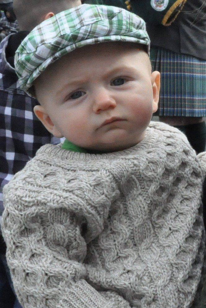 Irish baby, with his flat cap and aran sweater. Historically the patterns in the sweater designated one's clan so that fishermen who were drowned at sea could later be identified.