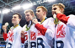 From left: James Guy, Duncan Scott, Dan Wallace and Stephen Milne pose with their medals. Photograph: Bernd Thissen/EPA  -  August 10, 2016