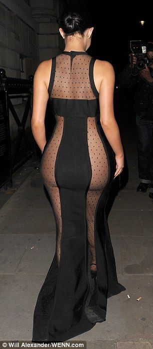 Peachy! The mesh panels stretched across her rounded derriere, leaving much of it on show...