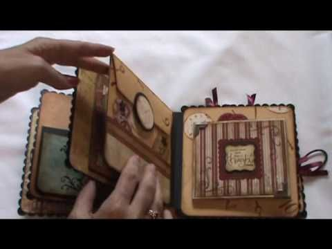 Mini album with tons of ideas for pockets, tags, etc.  WOW!  A lot to take in!  Cute