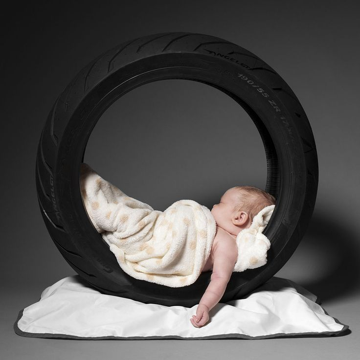 "This baby is ""Tire'd"":)   Beautiful new born sleeps in a Pirelli motorcycle tire artire.com"