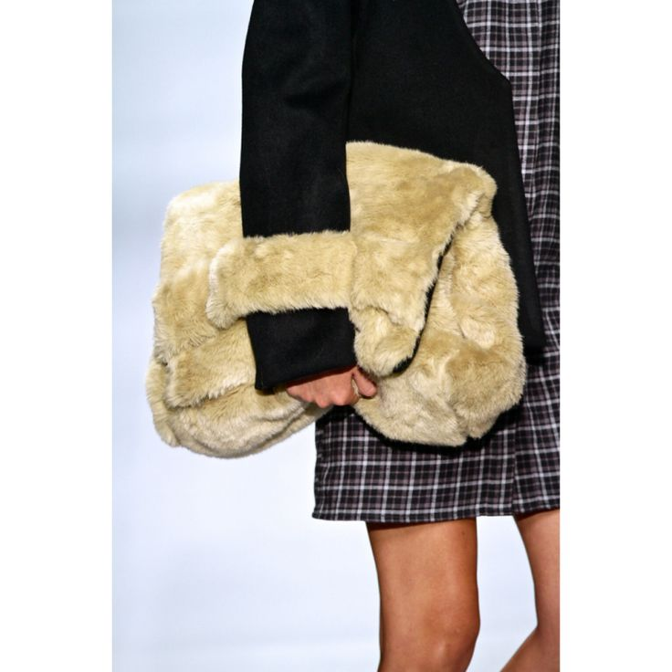 Warm and furry | bag                                   Designer: Adriaan Kuiters @ MBFWJ SCC, Sandton Johannesburg.                 Photo credit: Simon Deiner/ sdr photo