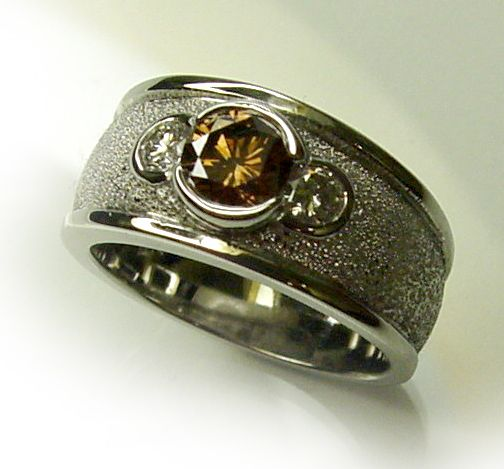Chibnalls custom re-model using customers stones featuring an Australian Cognac diamond set in 18ct gold.