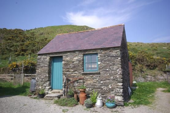 Small outbuildings sheds smallholding goat farm for Stone garden shed designs