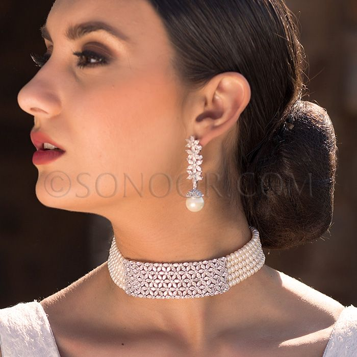 NEC/1/3707 Urmila Necklace Set with Earrings (Choker) in silver rhodium finish studded with white czee stones stringing in fresh water pearls
