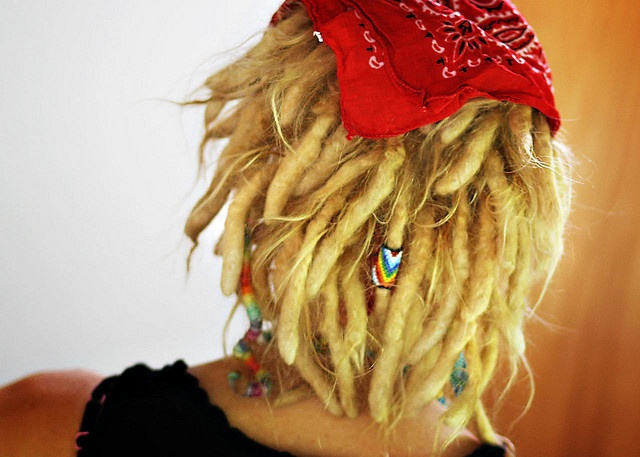 Short, blonde dreads.