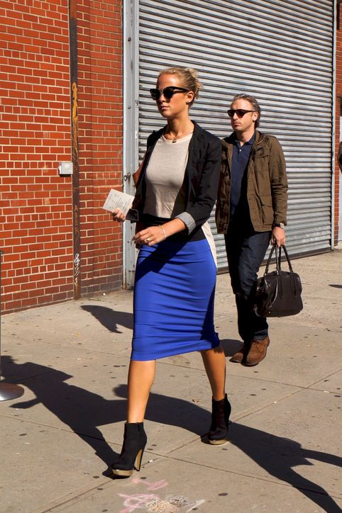 Wear a body-con skirt with ankle boots.