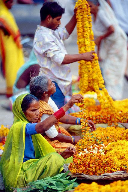 Flower Garland Sellers by photosbypjt, via Flickr