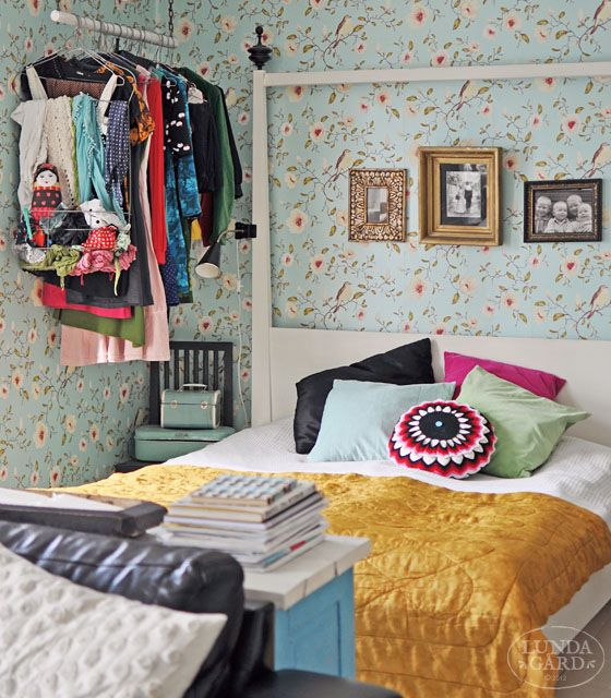 This isn't really my style but I like the wallpaper and interesting bed frame.
