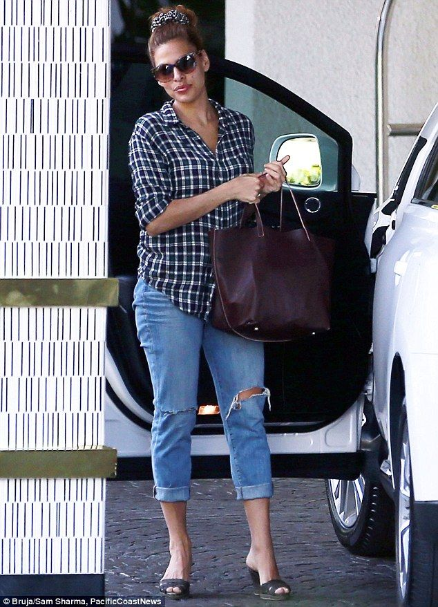 Natural beauty: Eva Mendes went for a low-key look as she arrived at the London hotel in West Hollywood on Tuesday