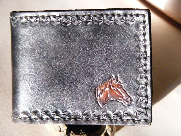 """This is hand tooled, hand stamp and hand sewn wallet made from top notch leather. The size is 4-5/8"""" x 3-1/2 """" closed. 6 slots for your cards and one currency slot. You can choose the colour. $50"""