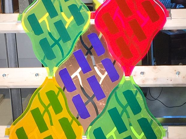 .11 m^2 leaf-shaped, colorful photovoltaic modules with solar concentrators
