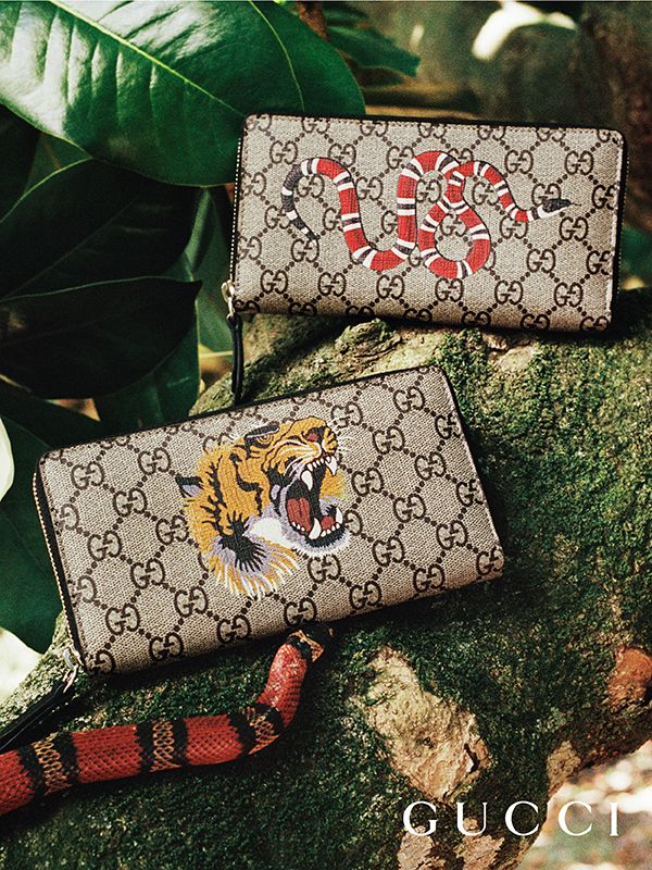 Presenting gifts from the Gucci Garden. Wallets from Gucci Gift in GG motif feature animals from the Gucci Garden, a kingsnake, and a tiger.