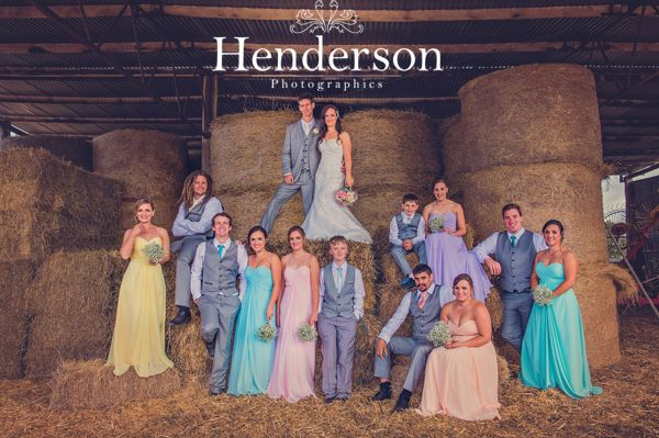 Colourful pastel bridal party in Australian hay bale shed. https://www.facebook.com/HendersonPhotographics