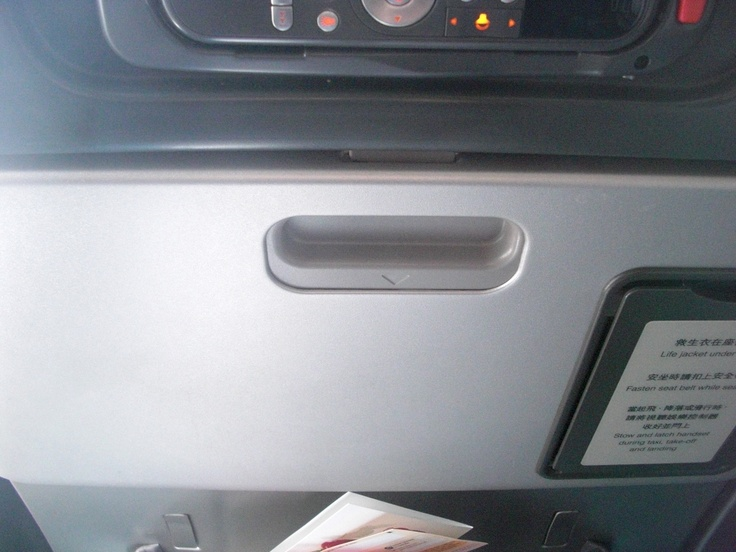A table in an airplane seat. The logical thing would be to push the thing up, but you need to push it down to open it, and push it back up to close it. o.0