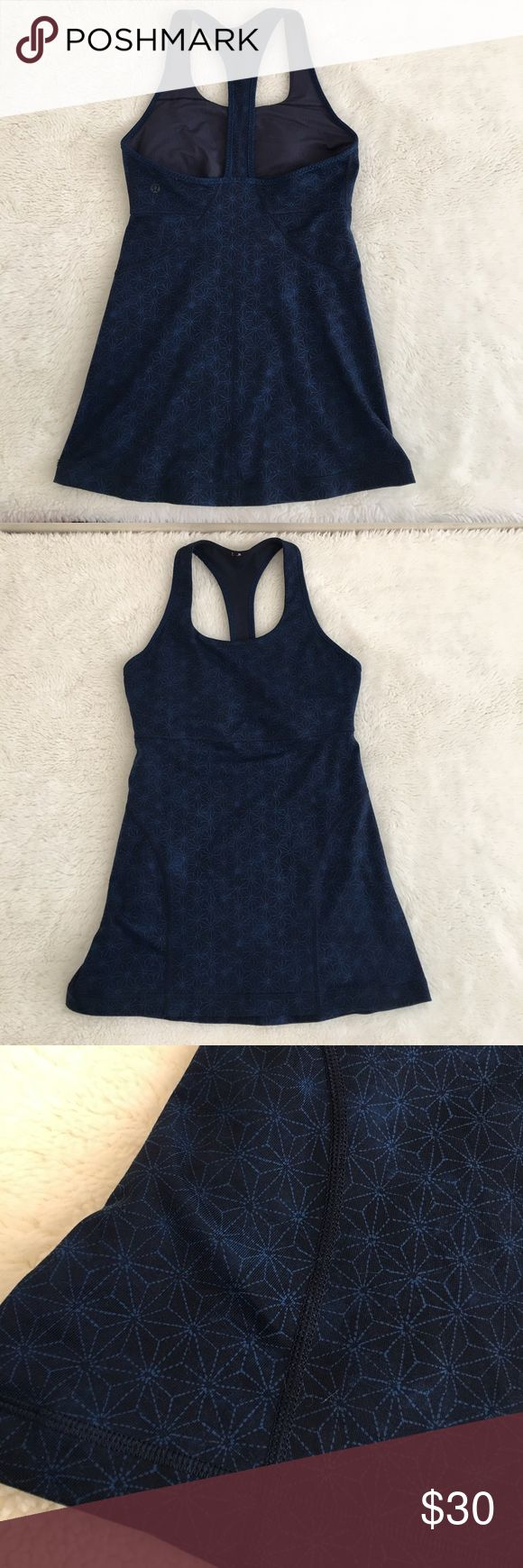 Lululemon Navy Blue and Black Tank Top Size 6 Pre-owned authentic Lululemon Navy Blue and Black Tank Top Size 6. Excellent like new condition. Has builtin bra. Please look at pictures for better reference. Happy Shopping! lululemon athletica Tops Tank Tops
