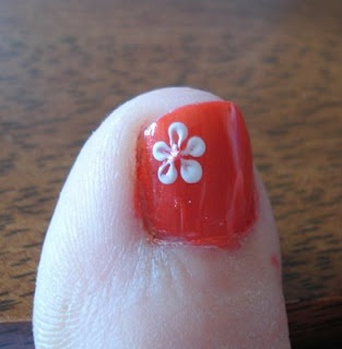 NO this isn't my toe. Brave woman putting her toes on a Blog! This is my favorite pedicure flower! We do this all the time - super easy. Just let the dots dry for a bit before you streak them in with a toothpick.