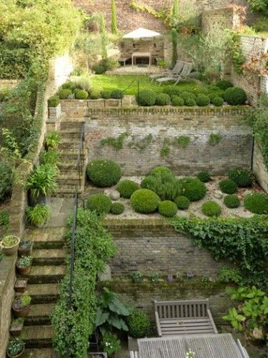 Many level garden landscaping a slope pinterest for Small sloping garden designs