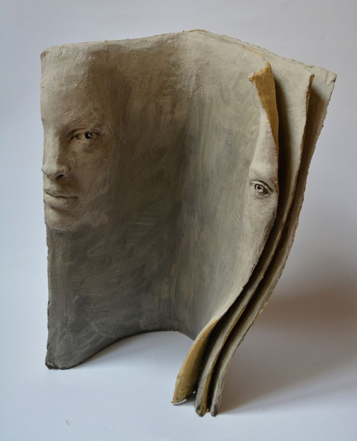 Paola Grizi -Terracotta Book Sculptures Tell Deep Stories with Faces - My Modern Met