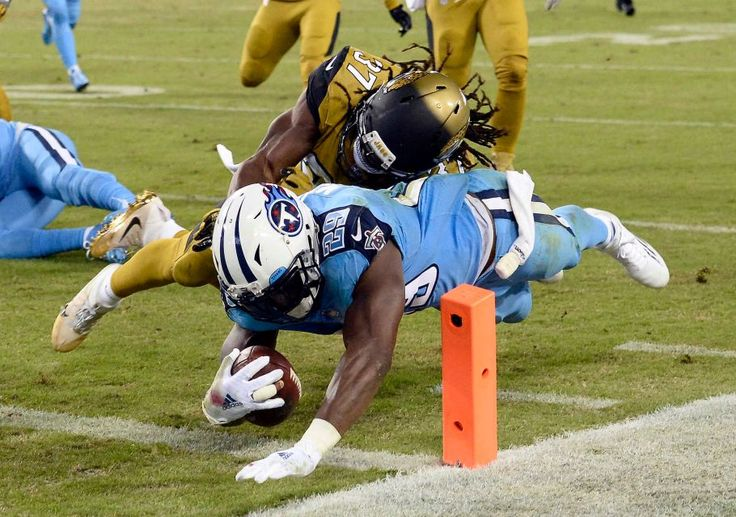 Thursday Night Football: Jaguars vs. Titans:    October 27, 2016  -  36-22, Titans   -     Tennessee Titans running back DeMarco Murray (29) beats Jacksonville Jaguars safety Johnathan Cyprien (37) to the end zone as Murray scores a touchdown on a 14-yard run in the first half of an NFL football game Thursday, Oct. 27, 2016, in Nashville, Tenn.