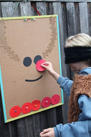 Turn an old bulletin board into a pin-the-nose-on-the-reindeer game for the kids' table. | 38 Clever Christmas Hacks That Will Make Your Life Easier