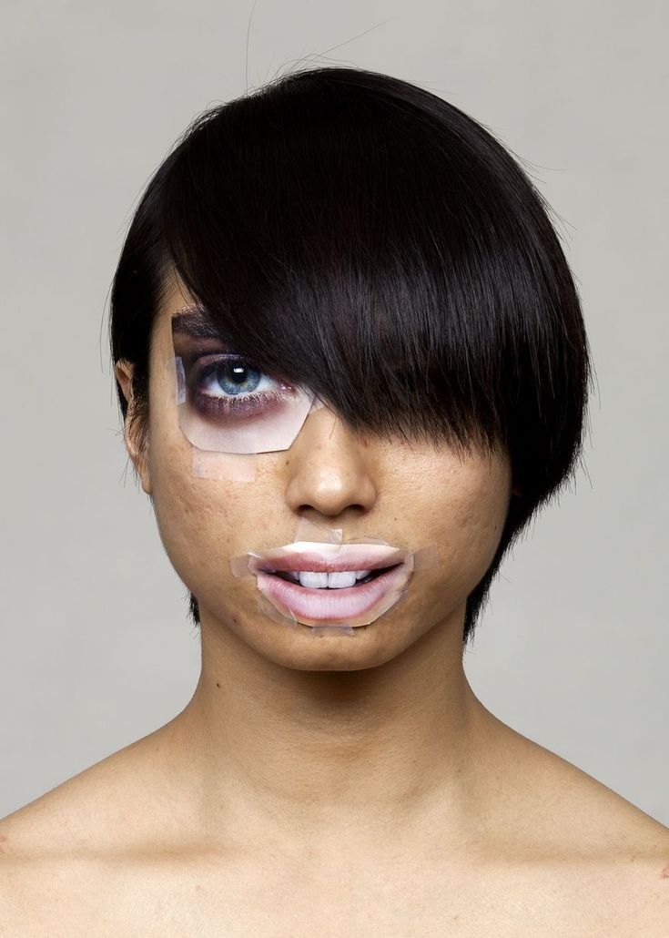 Artists perform plastic surgery with fashion magazine cut outs