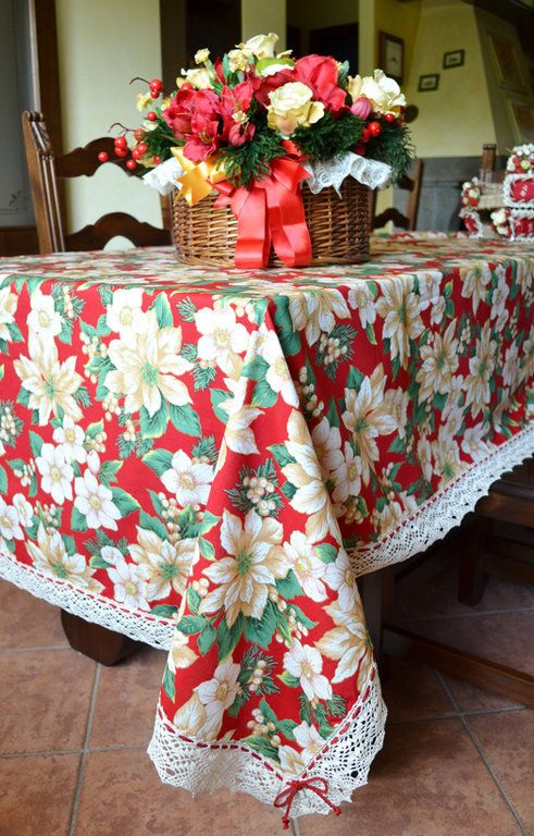 POINSETTIA TABLE CLOTH - PatriziaB.com  The warmth and joy of Christmas are the masters of the pattern of this beautiful pure cotton Yultide table cloth