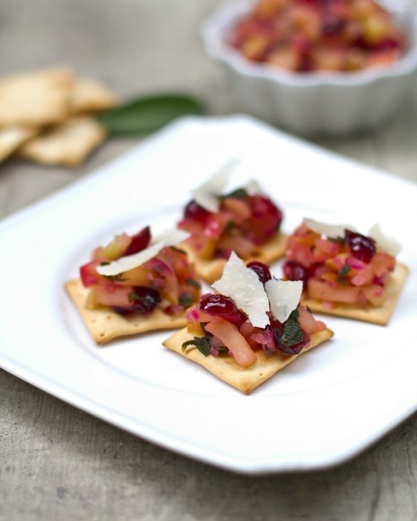 Autumn Apple Cranberry Sage Bites...apples, dried cranberries, diced onion bits, olive oil...topped with parmesan...or blue cheese, cream cheese dollop, or even Brie..a touch of sage. Load up a cracker, french bread, pita wedge and enjoy!