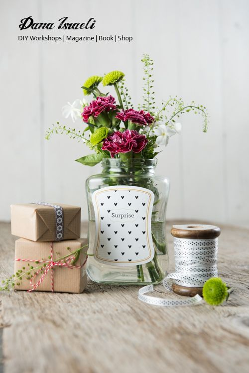 Transform an empty coffee jar into a flower jar centerpiece. Designed and Photographed for NESCAFE brand by Dana Israeli