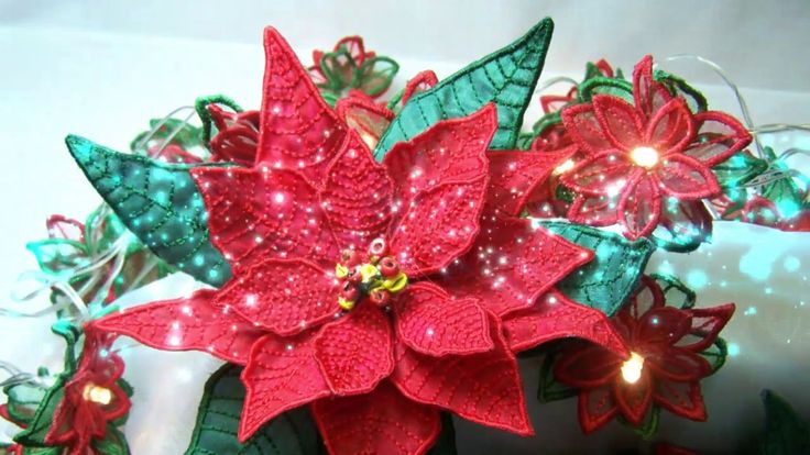 Poinsettia Organza And Poly  cotton Flowers Machine Embroidery Design Patterns. Christmas Embroidery Decorations. Christmas Flowers. Applique designs. Christmas In the hoop. In the Hoop designs. Christmas Poinsettia Flower www.embroidershoppe,com