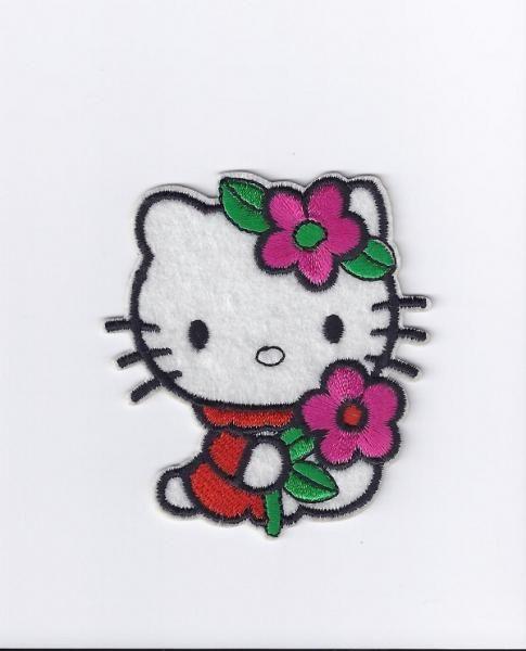 Hello Kitty - med blomst i håret og rød kjole. Lappelaaven.no