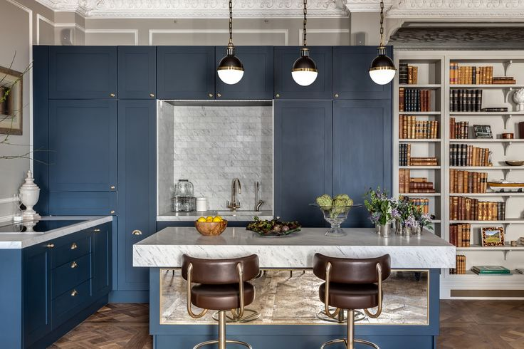 Gatti House - Apartment Two - Barlow & Barlow, Grey Tile, Blue Kitchen, Marble Worktop, Brass Cup handle, Brass Tap, Leather Barstool, Breakfast Bar, Pendant Lighting, Bookcase, Gold Tap, Classic Kitchen, Shaker Kitchen