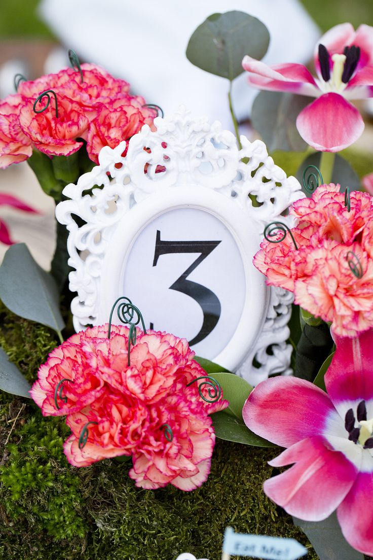 Alice in Wonderland theme wedding table number. Created by Three Wishes Events and Weddings. Check us out on Facebook: Three Wishes Events and Weddings or visit our website: www.threewew.com