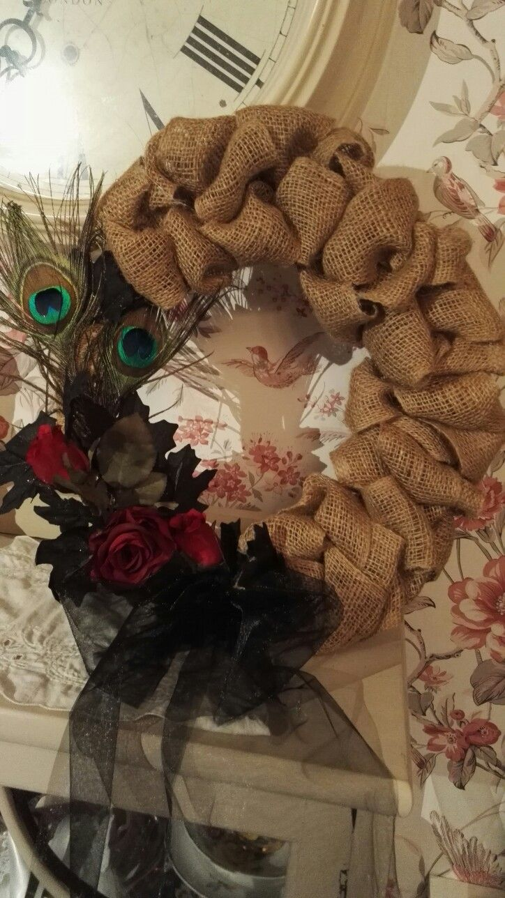 Romantic gothic burlap wreath.. Peacock feathers and dark red roses ..